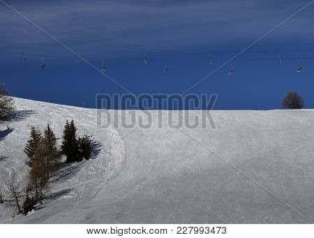 Winding Snowboard Trace And Chairlift Shadow On White Snow