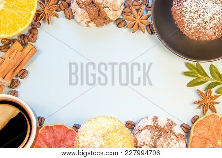 Topview With Copyspace On A Blue Background Decomposed Cupcakes With Biscuits And Cup Of Coffee, Sli