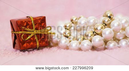 Web Banner Of Birthday Gift Box And Pearls For Females On Pink Background