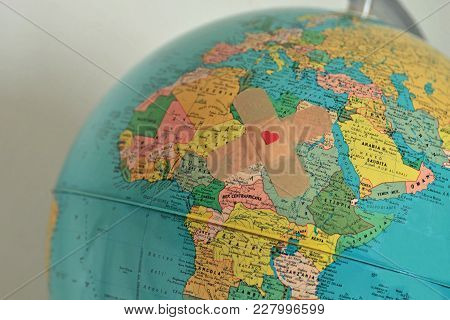 World With Plaster With Heart - Solidarity And Aid To Countries In Need Concept