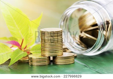 Money Savings Concept - Gold Coins With A Jar Glass