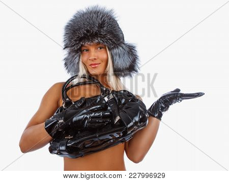 Topless Woman In A Fur Hat Holding Traveller Bag. Isolated On A White Background.