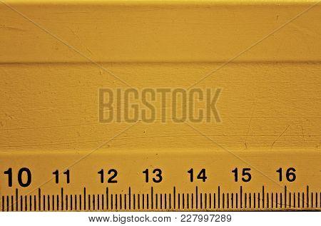 A Detail Of A Orange Ruler Detail