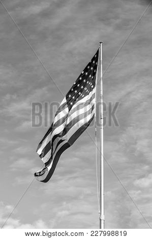 American Flag Against Blue Sky At Summer Day