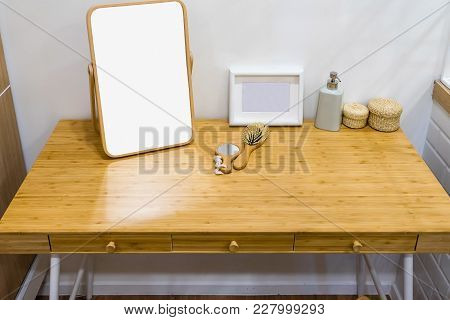 Beauty And Make-up Concept: Mirror, Comb And Makeup Set On A Modern Style Wooden Dressing Table