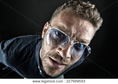 Macho In Glasses Look With Curious Face On Dark Background. Fashion, Style, Accessory. Beauty, Barbe
