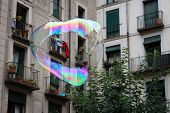 Colorful flying bubble. Symbolism of bubbles is fleeting, fragility, hopes, dreams, childhood innocence... poster