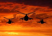 militant helicopter mi-24 silhouette in sunrise poster
