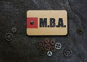 MBA (Master's of Business Administration) text on a paper tag, with gears poster