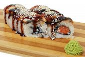 Sushi sauce and sesame seeds on a wooden tray poster