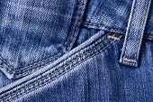 Blue jeans pocket. Macro shot of indigo fabric poster