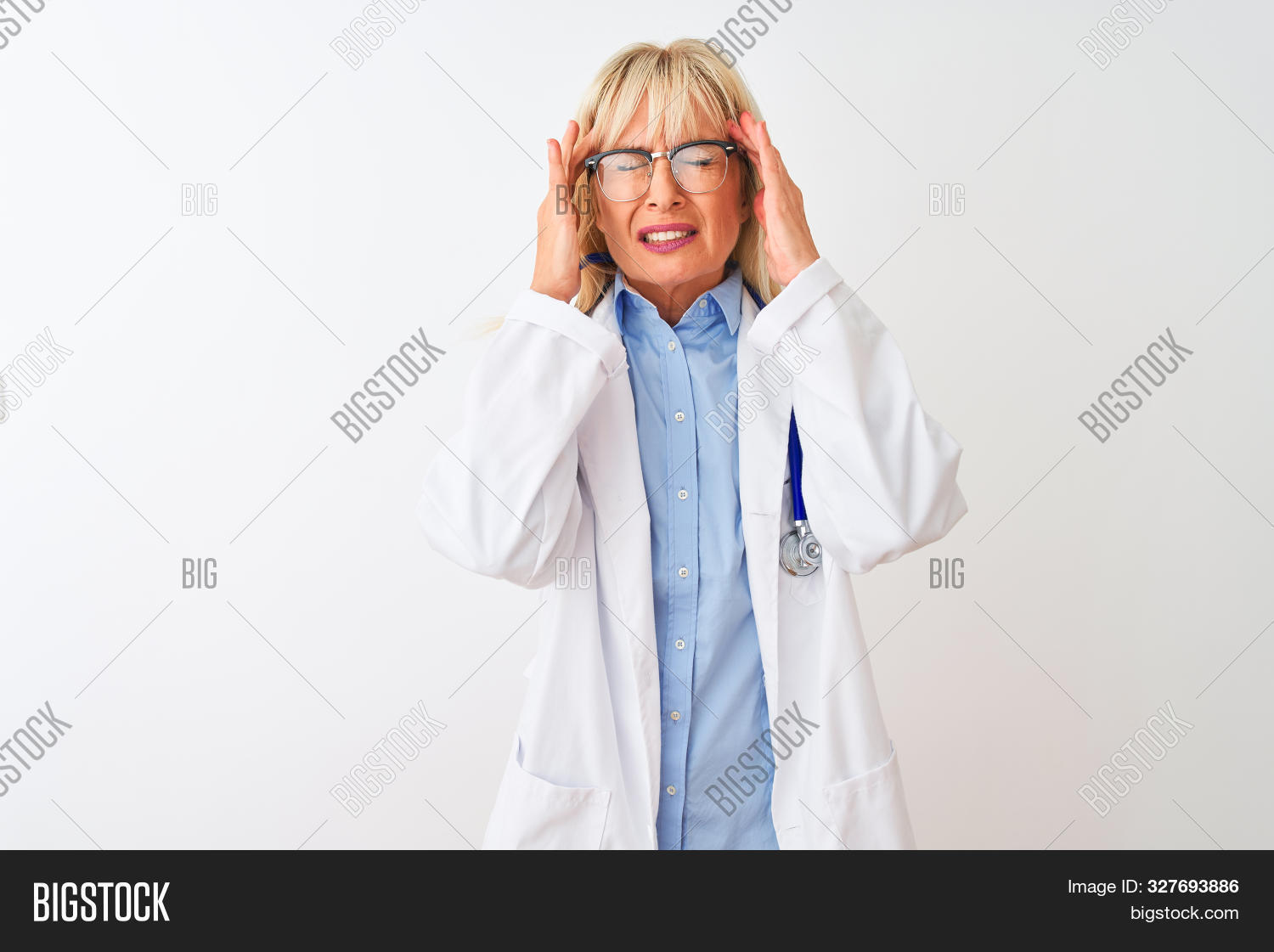 Middle age doctor woman wearing glasses and stethoscope over isolated white background with hand on head for pain in head because stress. Suffering migraine.