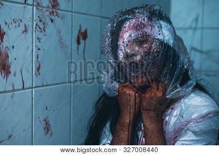 Horror Scence Of Woman Cover The Plastic Bag In Head In Toilet  At Abandoned House.ghost Women Wear