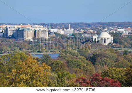 Washington DC skyline with Washington Monument, United States Capitol building, and Potomac River in Autumn foliage