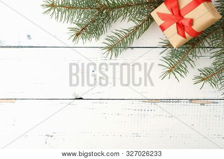 Gift Boxe With A Large Red Bow Against A Background Bokeh Of Twinkling Party Lights. Luxury New Year