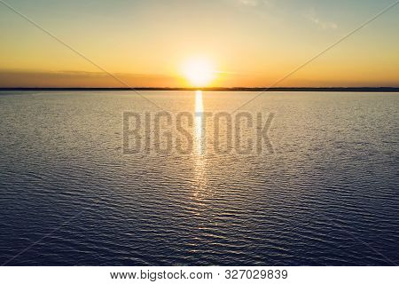Dramatic Golden Beach Sunset Sky And Tropical Sea Background. Yellow Sun Sets Behind The Lake. Beaut