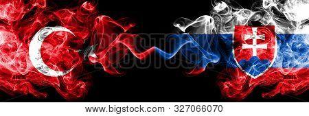 Turkey Vs Slovakia, Slovakian Smoke Flags Placed Side By Side. Thick Colored Silky Smoke Flags Of Tu