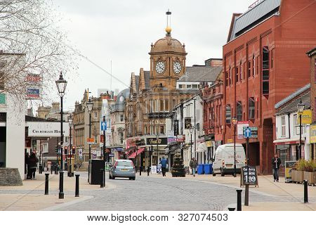 Bolton, Uk - April 23, 2013: People Visit A Shopping Street In Bolton, Uk. Bolton Is Part Of Greater