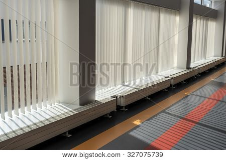 Large Glass Windows With Vertical Blinds In A Modern Building.