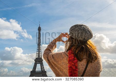 Traveler Girl Making Heart With Hands In Paris. Young Traveler Girl In Vacation. Girl Traveling To P