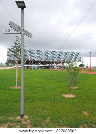 Herzogenaurach, Germany - August 19, 2019:  Direction Sign And Building Called Arena, The New 2019 O