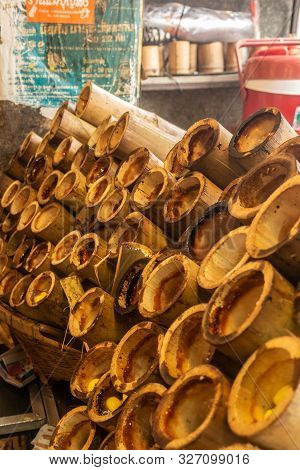 Chon Buri, Thailand - March 16, 2019: Closeup Of Light Brown Stack Of Empty Bamboo Cake Holders On S
