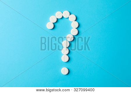 Question Mark Layd Out Of Pills On Blue Background, Space For Text