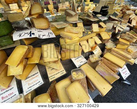 Brunnenmarkt, Vienna, Austria - October 11, 2019: Different Varieties Of Cheese Are Offered On The M