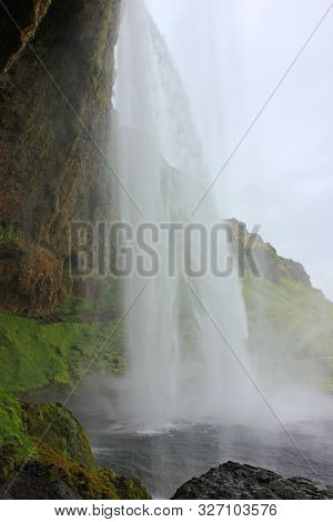 Behind the impressive seljalandsfoss waterfall in iceland