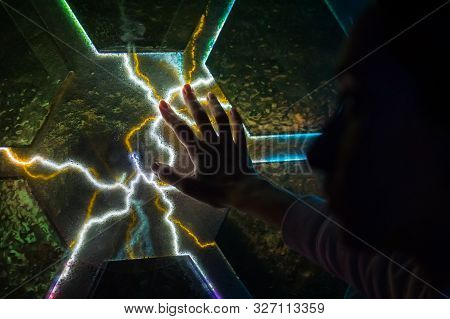 Woman Hand Touching Plasma Panel Display. Interactive Touchscreen Exposition In Science Museum. Elec
