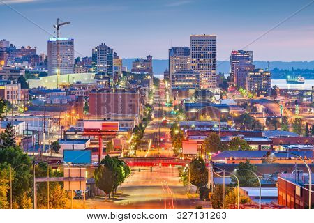 Tacoma, Washington, USA cityscape over Pacific Ave at twilight. poster
