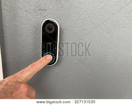 Orlando,fl/usa-10/10/19: A Person Pressing A Ring Doorbell That Has A Motion Sensor Camera And Is A
