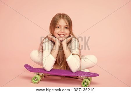 Enjoying Life In The Extreme Speed. Happy Small Extreme Athlete Relaxing At Violet Penny Board On Pi
