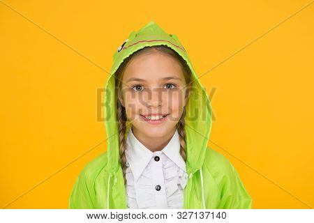 Bright Smile Whatever The Weather. Little Girl With Cute Smile In Hood On Yellow Background. Smiling