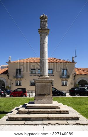Cascais - August 14, 2019: Detail Of The Pillar With The Portuguese Coat Of Arms And Crown On Top Of