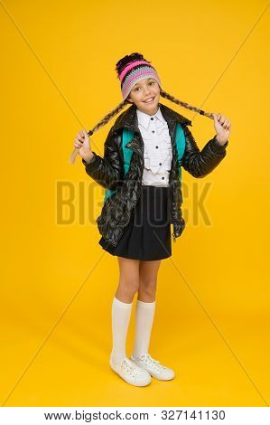 poster of Long and braided. Adorable little child smile with long blond hair braids on yellow background. Happy small girl with long hairstyle in autumn style. Styling long hair for school time.