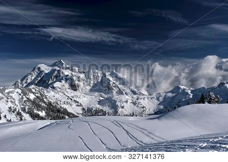 Ski Tracks On Fresh Snow With A Beautiful View Of Mountains In Mount Baker Ski Area. Fresh And Heavy