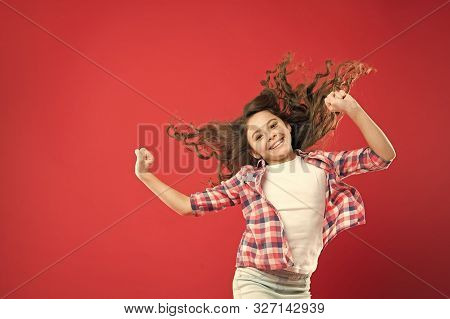 Going To Prom. Cute Small Girl With Wavy Prom Hairstyle On Red Background. Adorable Little Child Wit