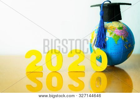 2020 Global Education Concept, Graduation Cap On Globe Model. Concept Of Global Business Study, Educ