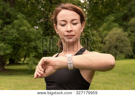 Health Sport Young Readhead Woman Doing Sport Outdoor And Look On Watch Clock