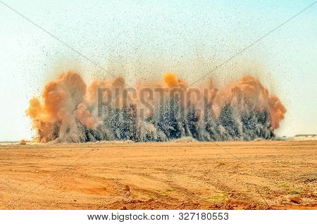 Flying Rock And Dust Clouds During Detonator Blasting