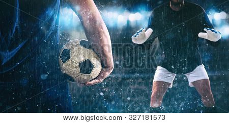 Soccer Scene At Night Match With Close Up Of A Soccer Striker Holding The Ball Against The Opposing