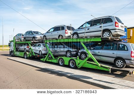 Zelva, Belarus -  September 2019: Car Carrier Truck  Loaded With Many Cars In The Parking Lot