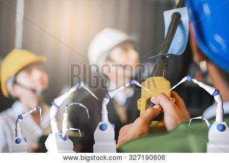 poster of people engineer factory inspection Controlled robot ai machine assist production engineer in industry wears helmet male working metalwork control in industrial In a plastic factory for car