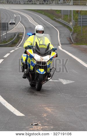 Police motorcyclist in the rain