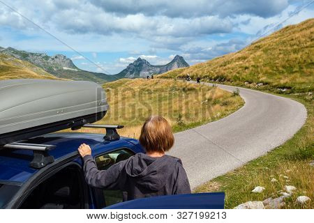 Woman With Car (model Unrecognizable) On Durmitor Panoramic Road. Picturesque Summer Mountain Landsc