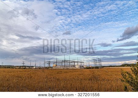 Electrical Sub Station Against The Cloudy Sky. Energy Generation Landscape.