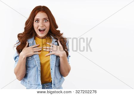 Surprised Grateful Cute Astonished Redhead Girl With Long Red Curly Hairstyle, Hold Hands On Chest F