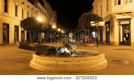 Gyor, Hungary 08 10 2019 : Statue Of Man Rowing On A Boat In The Hungarian City Gyor At Night