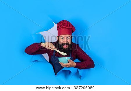 Healthy ration. Chef wear hat and apron looking through paper hole. Cook preparing food. Man professional chef hold bowl and spoon. Dieting concept. Bearded chef in uniform. Healthy food. Eat healthy poster